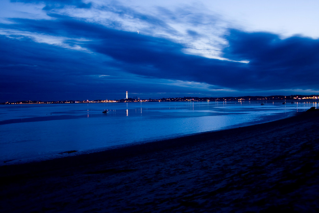 07/30/09 Sapphire Seascape<br /> <br /> The sea and sky appear surreal surrounding Provincetown at dusk.
